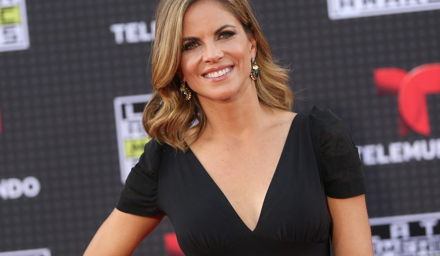 """FILE- In this Oct. 8, 2015, file photo, Natalie Morales arrives at the Latin American Music Awards at the Dolby Theatre in Los Angeles. NBC """"Today"""" show anchor Morales is moving West to become host of the entertainment show """"Access Hollywood,"""" but will keep a role on the morning program. NBC said Wednesday, May 4, 2016, that it hasn't been determined whether she will continue to host the third hour from California or if that role will go to someone else. (Photo by Paul A. Hebert/Invision/AP, File)"""