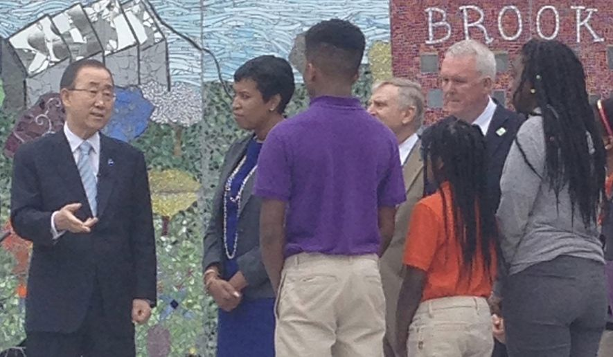 Accompanied by D.C. Mayor Muriel Bowser, U.N. Secretary-General Ban Ki-Moon meets with students at Brookland Middle School and tours the school's glass-walled halls up to the rooftop, which is lined with solar panels. (Faith E. Pinho/THE WASHINGTON TIMES)