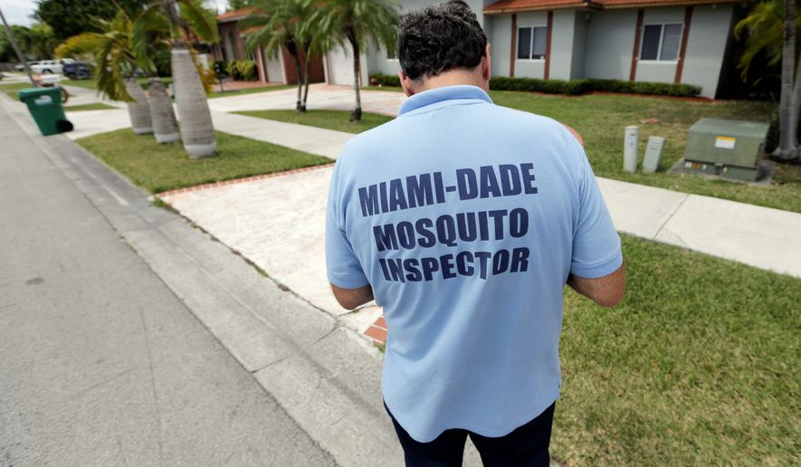Mosquito inspector Giraldo Carratala responds to a complaint in a Miami neighborhood. Health officials are concerned about the Zika virus and the mosquitoes that spread it. (Associated Press)