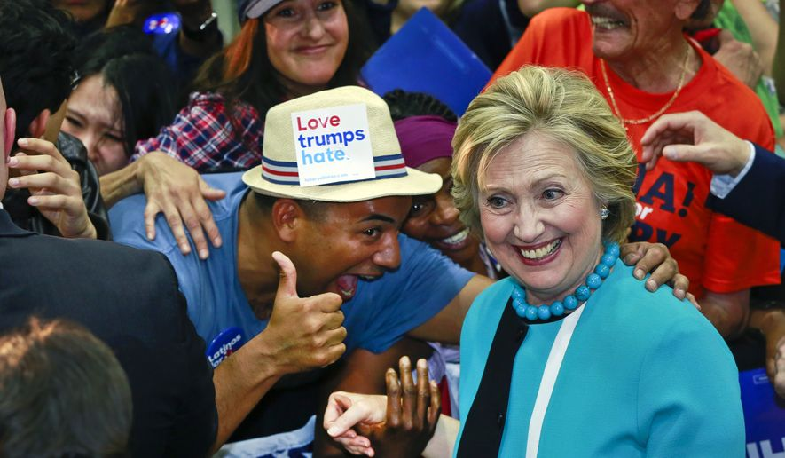 Democratic presidential candidate Hillary Clinton greets supporters as she campaigns at East Los Angeles College in Los Angeles, Thursday, May 5, 2016. (AP Photo/Damian Dovarganes)