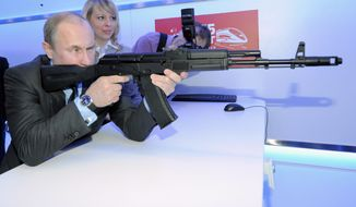 Russian Prime Minister Vladimir Putin Putin aims at a target with a replica of the AK-47 assault rifle in a shooting gallery while attending an exhibition of Russian Railways' research center in Moscow, Thursday, April 26, 2012. (AP Photo/RIA-Novosti, Alexei Druzhinin, Government Press Service) ** FILE **