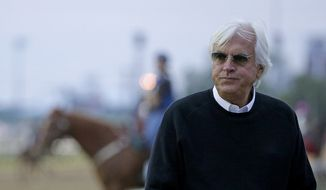 Trainer Bob Baffert watches a workout at Churchill Downs Tuesday, May 3, 2016, in Louisville, Ky. The 142nd running of the Kentucky Derby is scheduled for Saturday, May 7. (AP Photo/Charlie Riedel)