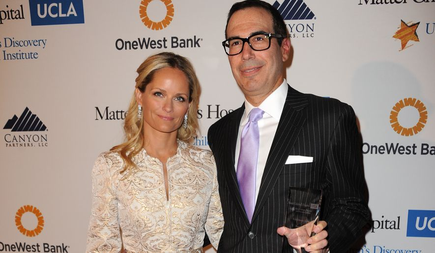 """Heather Mnuchin, left, and Steven Mnuchin arrive at The Kaleidoscope Ball's """"Designing The Future"""" at the Beverly Hills Hotel on Wednesday, April 17, 2013 in Beverly Hills, Calif. (Photo by Richard Shotwell/Invision/AP)"""