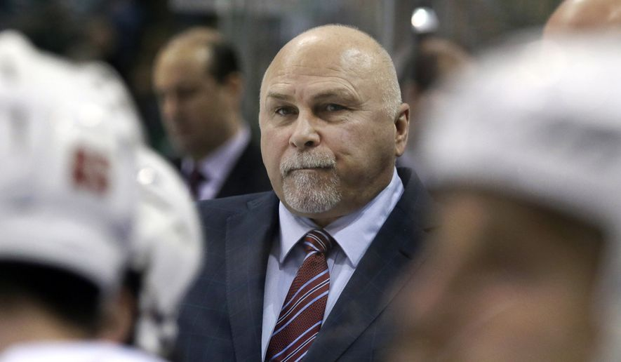 Washington Capitals head coach Barry Trotz watches play from the bench during the first period of an NHL hockey game against the Dallas Stars Saturday, Feb. 13, 2016, in Dallas. (AP Photo/LM Otero)