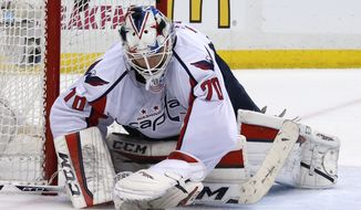 Washington Capitals goalie Braden Holtby (70) stops a shot during the second period of Game 4 in an NHL hockey Stanley Cup Eastern Conference semifinals against the Pittsburgh Penguins in Pittsburgh, Wednesday, May 4, 2016. (AP Photo/Gene J. Puskar)