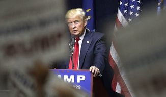 """FILE - In this Wednesday, April 6, 2016, file photo, Republican presidential candidate Donald Trump speaks during a campaign rally, in Bethpage, N.Y. Trump says he would create coal-mining jobs as president, and he criticizes Hillary Clinton for saying """"we're going to put a lot of coal miners"""" out of work. Trump, however, has yet to explain exactly how he will revitalize Appalachia's coal industry. (AP Photo/Julie Jacobson, File)"""