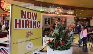 In this Tuesday, Feb. 9, 2016, file photo, a restaurant posts a sign indicating they are hiring, in Miami. (AP Photo/Alan Diaz, File)