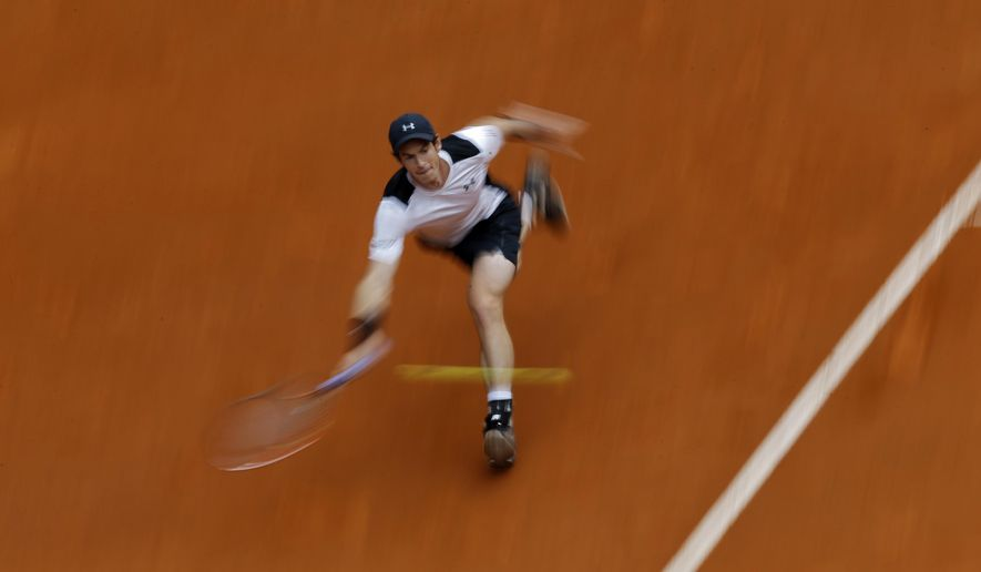 In this photo taken with a slow shutter speed, Andy Murray, from Britain, returns a ball against Gilles Simon, from France, during a Madrid Open tennis tournament match in Madrid, Spain, Thursday, May 5, 2016. Murray won 6-4 and 6-2. (AP Photo/Francisco Seco)