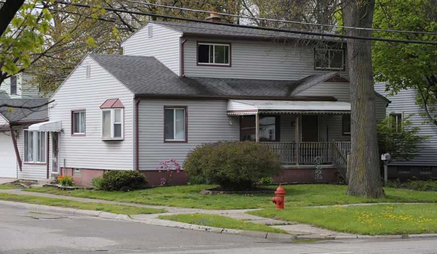 The house where 21-year-old Jessica White's body was found Tuesday night is seen in Hazel Park, Mich., Wednesday, May 4, 2016. Hazel Park police said they have arrested a 23-year-old man who lived in the home. He's described as a friend of hers. (Clarence Tabb Jr./Detroit News via AP) MANDATORY CREDIT
