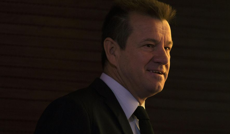 Brazil's soccer coach Dunga arrives to a news conference to announce which of his players will play the Copa America Centenario, in Rio de Janeiro, Brazil, Thursday, May 5, 2016. The Copa America Centenario will see the best national soccer teams from the American continent battle each other in the United States in June. (AP Photo/Felipe Dana)