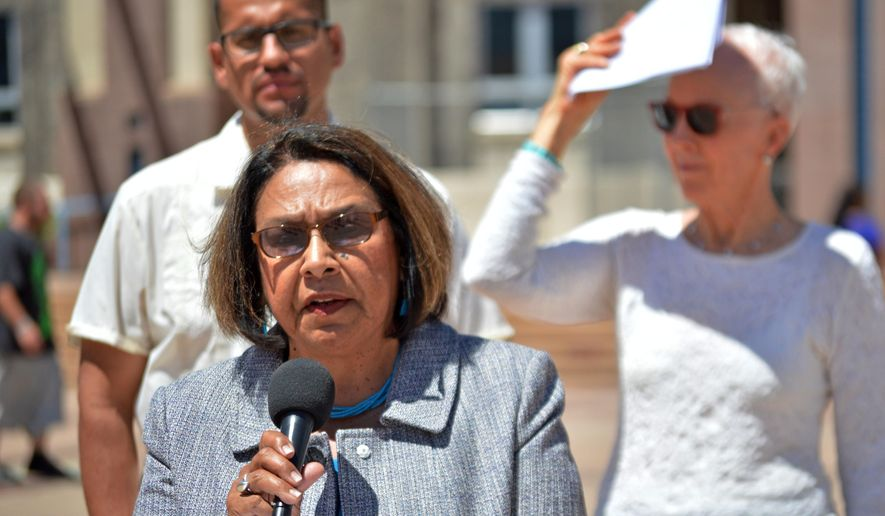State Rep. Patricia Roybal Caballero, D-Albuquerque, speaks at a press conference by the Democratic Party of New Mexico in downtown Albuquerque, N.M. to denounce the likely GOP presidential nomination of Donald Trump, Thursday May 5, 2016. Caballero and other New Mexico Democrats said Trump's rhetoric around immigration was hurtful to the state and the country.(AP Photo/Russell Contreras)