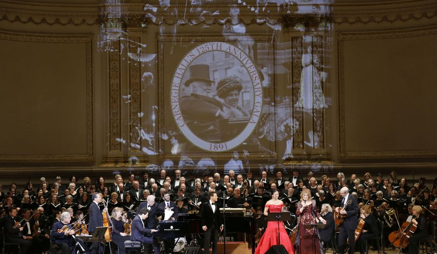 From left, Itzhak Perlman, Yo-Yo Ma, Lang Lang, Emanuel Ax, Michael Feinstein, Isabel Leonard, Renee Fleming and James Taylor perform during Carnegie Hall's 125th Anniversary Concert, Thursday, May 5, 2016, in, New York. The Oratorio Society of New York sang along as the Orchestra of St. Lukes played conducted by Pablo Heras-Casado. (AP Photo/Julie Jacobson)