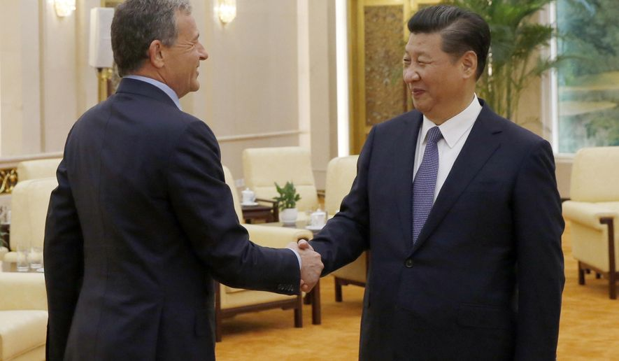 China's President Xi Jinping, right, talks with CEO of the Walt Disney Company Bob Iger as they meet at the Great Hall of the People in Beijing, China, Thursday, May 5, 2016. (Kim Kyung-hoon/Pool Photo via AP)