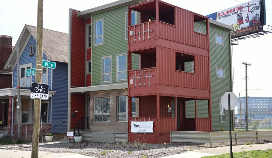 In a May 3, 2016 photo,Three Squared Construction's North Corktown model, made out of nine shipping containers, is complete, in Detroit. The 2,800-square-foot building at the corner of Trumbull and Pine Street only took six hours to piece together. For the next two years, the two-unit building will serve as the company's offices and a model. Three Squared Construction has three more shipping container condominium complexes in the works in tDetroit. (Tanya Moutzalias | MLive Detroit)