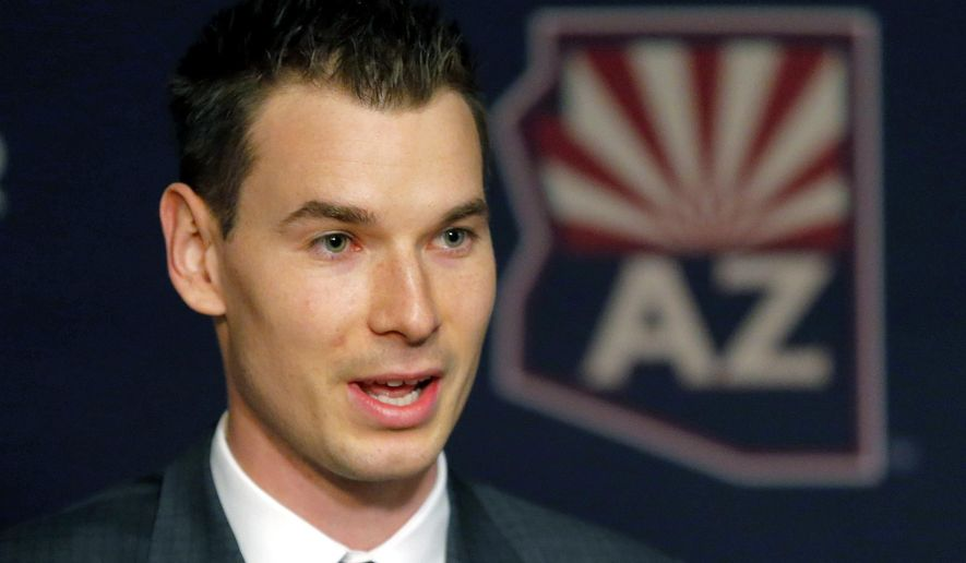 Newly appointed Arizona Coyotes general manager John Chayka speaks at a news conference announcing his promotion, Thursday, May 5, 2016, in Glendale, Ariz. Chayka is the youngest GM in NHL history. (AP Photo/Matt York)