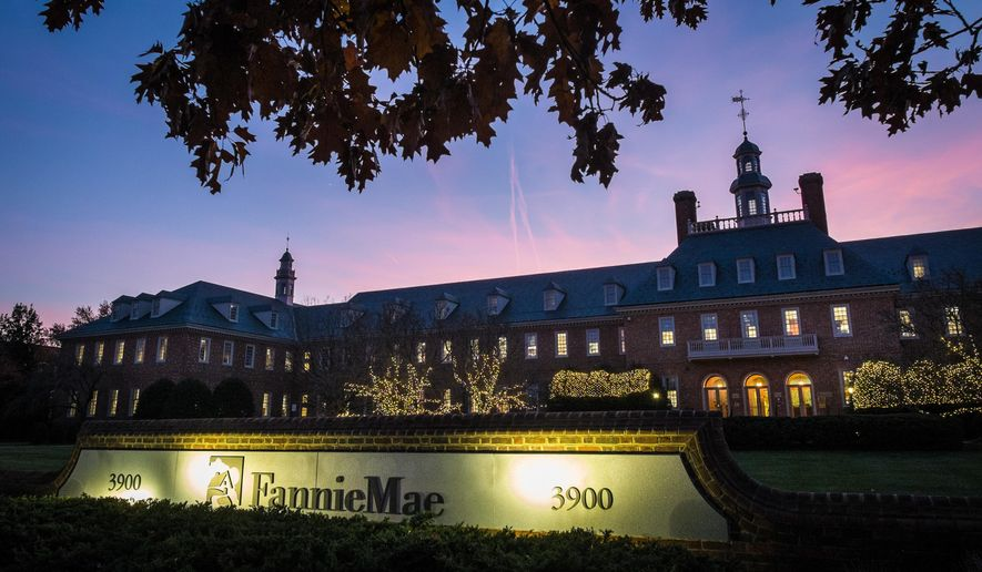 FILE - In this Nov. 20, 2013, file photo, the sun sets behind the Fannie Mae headquarters in Washington. Fannie Mae reports financial results Thursday, May 5, 2016. (AP Photo/J. David Ake, File)