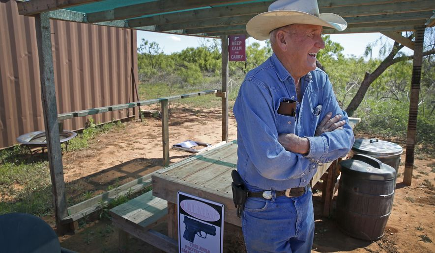 ADVANCE FOR SUNDAY, MAY 8, 2016 - In this Friday, April 22, 2016 photo, Buster Taylor smiles at his shooting range as he carries a handgun on his property in Gail, Texas. The Borden County town of about 650 people has the highest percentage of adults with Concealed Carry Permits, about 1 in 5, to carry a handgun than any county in Texas. (Jae S. Lee/The Dallas Morning News via AP) MANDATORY CREDIT; MAGS OUT; TV OUT; INTERNET USE BY AP MEMBERS ONLY; NO SALES