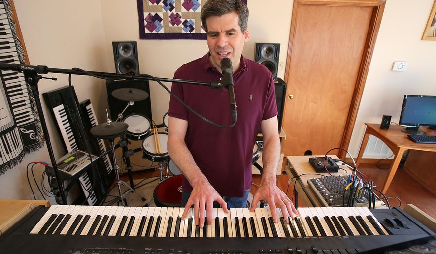 """In this Thursday, April 21, 2016 photo, Baylor psychology professor Keith Sanford, who is also a musician plays on his keyboard, in Waco, Texas. Sanford created a song in his home studio called """"Variance and Covariance"""" that he uses for class as a lecture tool. (Jerry Larson  /Waco Tribune-Herald via AP) MANDATORY CREDIT"""