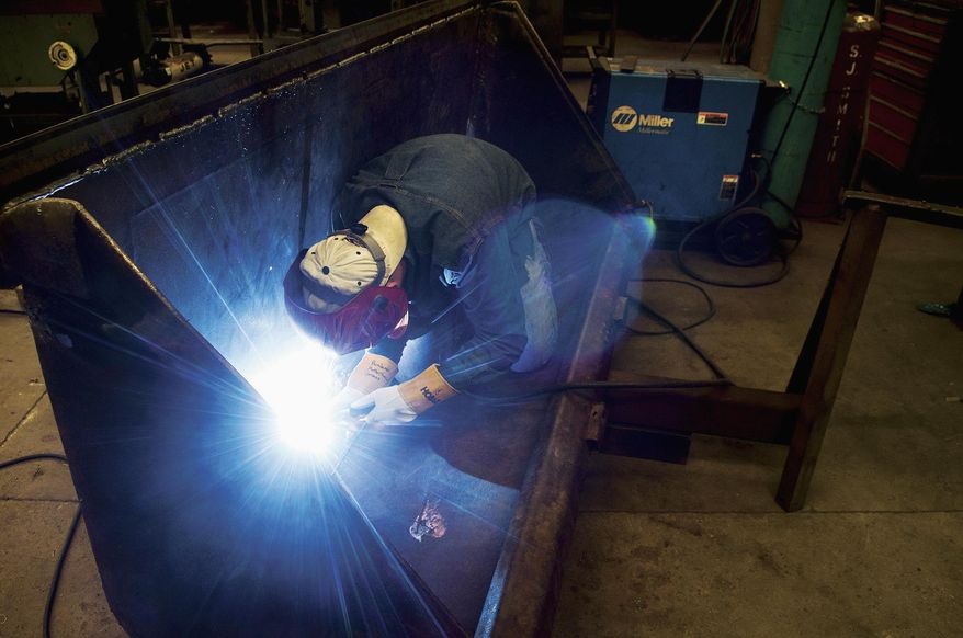 In this April 10, 2016 photo, Erie High School junior Ben Grimes, 16, works on a welding project during his Whiteside Area Career Center welding and manufacturing technology class in Sterling, Ill. Grimes got into welding a couple of years ago and would like to be a pipefitter, but said he'll do anything in welding and machining. (Alex T. Paschal/The Daily Gazette via AP) MANDATORY CREDIT
