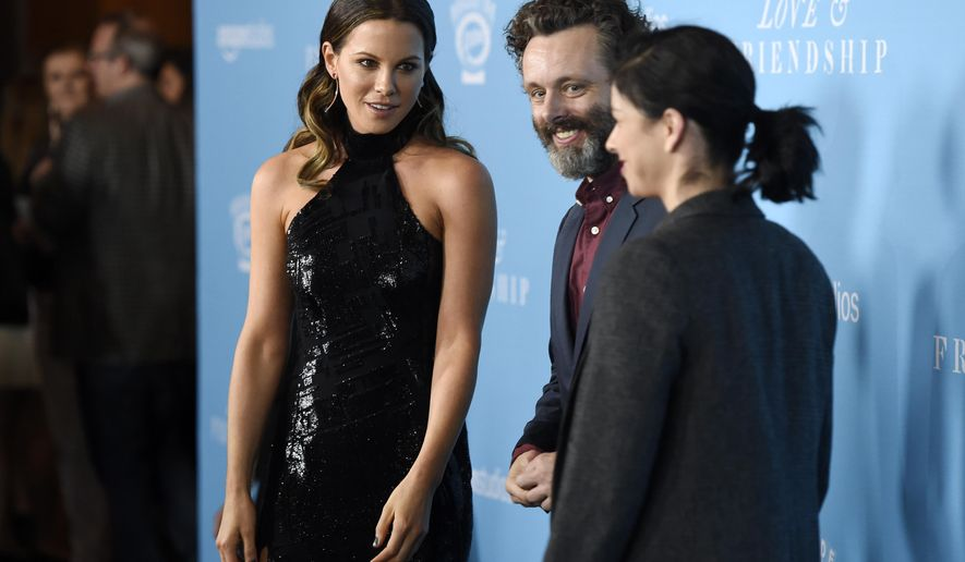"""Kate Beckinsale, left, a cast member in """"Love & Friendship,"""" greets actors Michael Sheen, center, and Sarah Silverman at the premiere of the film at the Directors Guild of America on Tuesday, May 3, 2016, in Los Angeles. (Photo by Chris Pizzello/Invision/AP)"""