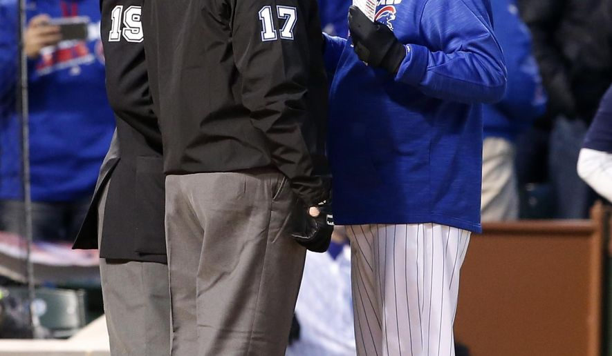 Chicago Cubs manager Joe Maddon, right, argues with home plate umpire Vic Carapazza and first base umpire John Hirschbeck after Dexter Fowler ejected by home plate umpire Vic Carapazza after the third inning of a baseball game against the Washington Nationals, Thursday, May 5, 2016, in Chicago. (AP Photo/Nam Y. Huh)