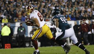 In this photo taken Dec, 26, 2015, Washington Redskins' Jordan Reed (86) runs for a touchdown after a catch against Philadelphia Eagles' Mychal Kendricks (95) in the first half of an NFL football game in Philadelphia. The Washington Redskins have signed tight end Jordan Reed to a multiyear contract extension. (AP Photo/Michael Perez)