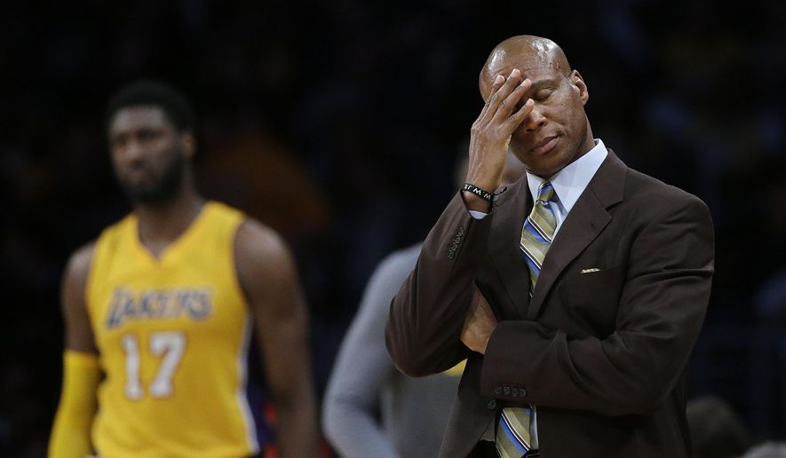 "FILE - In this March 4, 2016, file photo, Los Angeles Lakers coach Byron Scott wipes his forehead during the second half of the Lakers' NBA basketball game against the Atlanta Hawks in Los Angeles. Scott told ESPN in an interview broadcast May 4, 2016 that he was ""shocked"" the team fired him last week. (AP Photo/Jae C. Hong, File)"