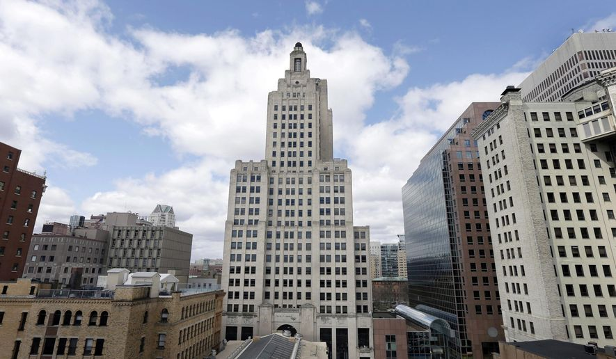 FILE - In this March 27, 2013 file photo the Bank of America Building, center, also known as the Superman building, stands among other buildings in downtown Providence, R.I. State lawmakers joined community and business leaders Thursday, May 5, 2016, inside Rhode Island's tallest skyscraper to announce a new campaign to get it refurbished. The Art Deco-style structure has been been vacant for more than three years. (AP Photo/Steven Senne, File)