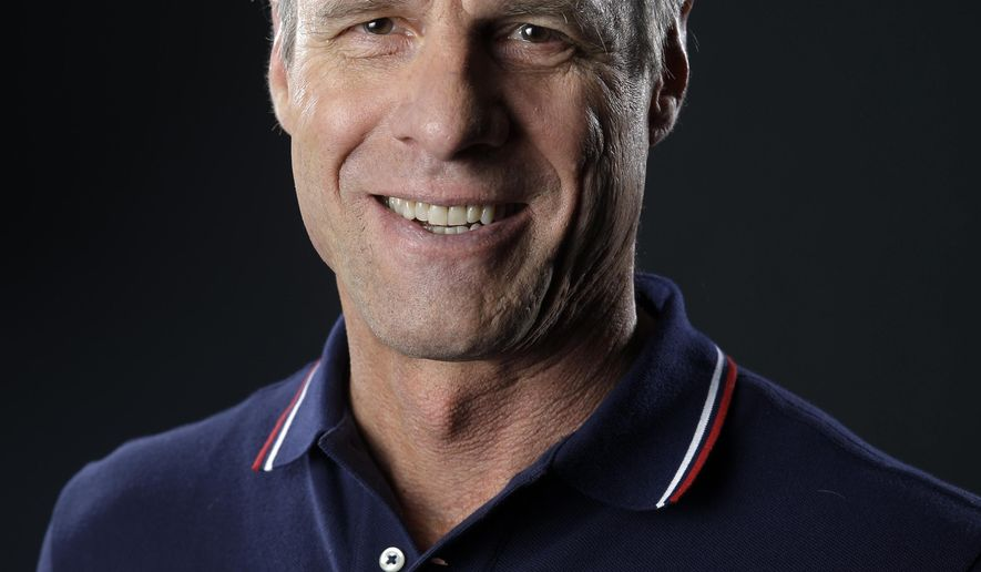 In this photo taken March 8, 2016, women's volleyball coach Karch Kiraly poses at the 2016 Team USA Media Summit in Beverly Hills, Calif. Kiraly will stay on to lead the top-ranked American women for the next Olympic cycle ahead of the 2020 Games in Tokyo, USA Volleyball announced Thursday, May 5, 2016. (AP Photo/Jae C. Hong)