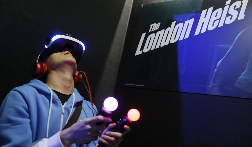 "FILE - In this Jan. 29, 2016 file photo, a video game enthusiast experiences the Playstation VR virtual reality headset with the game ""The London Heist"" at the Taipei Game Show 2016 in Taipei, Taiwan. After delaying orders because of component shortages and angering wannabe early adopters, VR company Oculus is confronting another headache as it seeks to technologically and culturally establish the immersive medium. It's now possible to play titles that were intended to only be used with the Oculus Rift system on an entirely different VR headset. (AP Photo/Wally Santana, File)"
