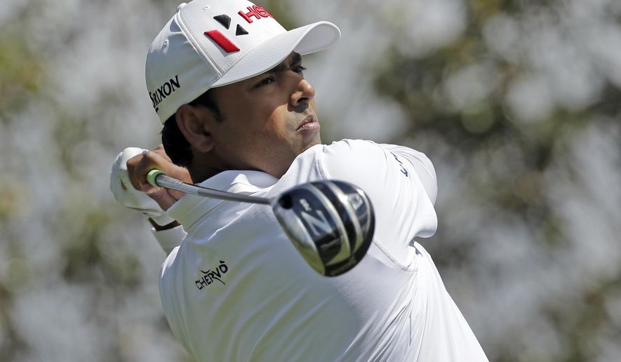 Anirban Lahiri watches his tee shot on the 16th hole during the first round of the Wells Fargo Championship golf tournament at Quail Hollow Club in Charlotte, N.C., Thursday, May 5, 2016. (AP Photo/Chuck Burton)