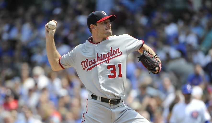 Washington Nationals starting pitcher Max Scherzer (31) throws against the Chicago Cubs during the first inning of a baseball game, Friday, May 6, 2016, in Chicago. (AP Photo/David Banks)