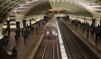 FILE - In this Jan. 13, 2015 file photo, a subway train arrives at the L'Enfant Metro Station in Washington. (AP Photo/Pablo Martinez Monsivais, File) **FILE**