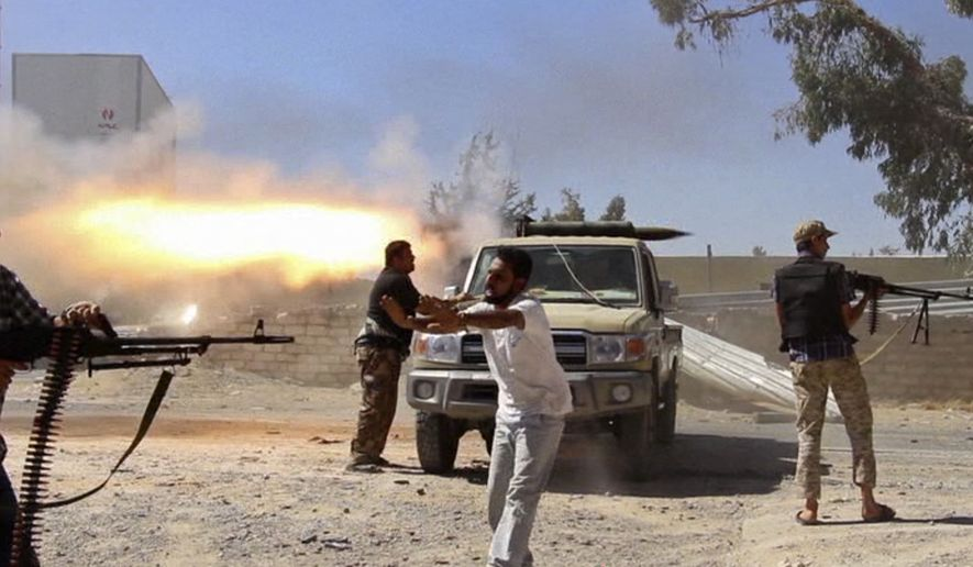 In this Saturday, July 26, 2014, file frame grab from video obtained from a freelance journalist traveling with the Misarata brigade, fighters from the Islamist Misarata brigade fire towards Tripoli airport in an attempt to wrest control from a powerful rival militia, in Tripoli, Libya. (AP Photo/AP video, File)