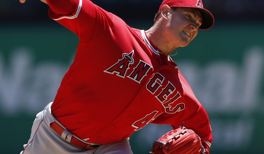 FILE - In this May 1, 2016 file photo, Los Angeles Angels starting pitcher Garrett Richards delivers to the Texas Rangers during the first inning of a baseball game, in Arlington, Texas. A person familiar with the situation tells The Associated Press that Angels ace Garrett Richards is expected to need surgery to repair a torn ligament in his right elbow, sidelining him into next season. The source spoke to The Associated Press on condition of anonymity because the team wasn't expected to make an announcement on Richards' condition until later Friday, May 6, 2016. (AP Photo/Jim Cowsert, File)