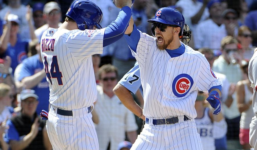 Chicago Cubs' Ben Zobrist, right, is greeted by Anthony Rizzo (44) after hitting a three-run home run against the Washington Nationals during the fifth inning of a baseball game, Friday, May 6, 2016, in Chicago. (AP Photo/David Banks)