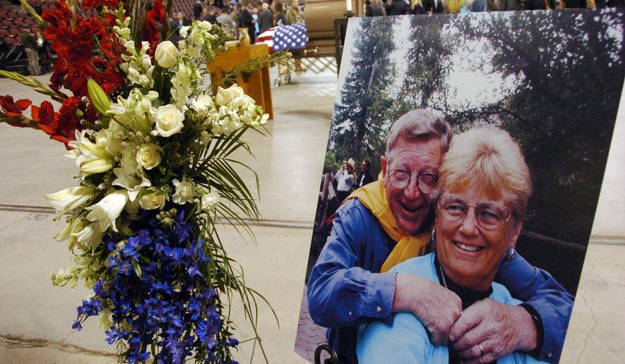 A photo of former Montana U.S. Sen. Conrad Burns and his wife, Phyllis, is displayed during a Friday, May 6, 2016, funeral service for the three-term lawmaker at the Metra Park Arena in Billings, Mont. Burns died last week at the age of 81. (AP Photo/Matthew Brown)