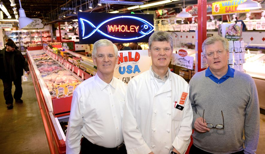 In this Feb. 23, 2016 photo, Sam Wholey, left, Jim Wholey, center, and Dan Wholey, part of the third generation to run the food market and restaurant Robert Wholey & Co., pose for a photograph at their market in the Strip District of Pittsburgh. Jim Wholey serves as president of the family business that was founded by his grandfather in 1912 in nearby McKees Rocks, Pa., and specializes in seafood, meats and other fresh food. (Pam Panchak /Pittsburgh Post-Gazette via AP) MAGS OUT; MONESSEN OUT; KITTANNING OUT; CONNELLSVILLE OUT; GREENSBURG OUT; TARENTUM OUT; NORTH HILLS NEWS RECORD OUT; BUTLER OUT; MANDATORY CREDIT