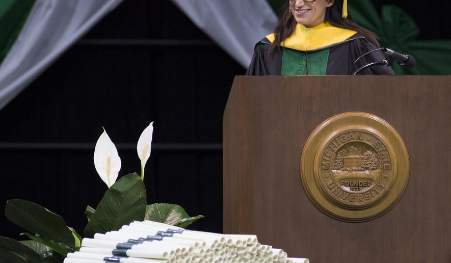 Dr. Mona Hanna-Attisha, Director of the Hurley Medical Center Pediatric Residency Program in Flint, Mich., and assistant professor of Pediatrics and Human Development for Michigan State University College of Human Medicine smiles to students before her  commencement address Friday, May 6, 2016, at the Breslin in East Lansing, Mich. Hanna-Attisha received an honorary degree from President Lou Anna Simon.  [Matthew Dae Smith /Lansing State Journal via AP)  NO SALES; MANDATORY CREDIT