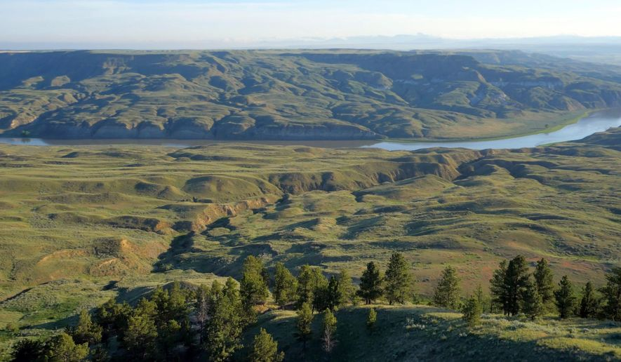 This June, 2014 photo provided by Ranch Videos.com shows a portion of the PN Ranch north of Winifred, Mont., with the Missouri River in the background. A huge Montana nature reserve added the historic, 47,000-acre ranch to its patchwork of lands along the Missouri River on Friday, May 6, 2016. It marks a major step in a privately-funded effort to stitch together a Connecticut-sized park on the Great Plains where bison and other wildlife can roam free. (Ranch Videos.com via AP)