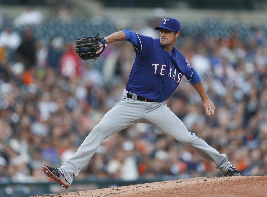 Texas Rangers pitcher Cole Hamels throws against the Detroit Tigers in the second inning of a baseball game Friday, May 6, 2016, in Detroit. (AP Photo/Paul Sancya)