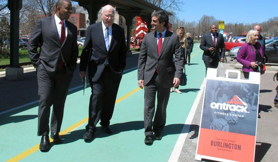 U.S. Transportation Secretary Anthony Foxx, left, U.S. Sen. Patrick Leahy, center, and Burlington, Vt., Mayor Miro Weinberger walk outside the passenger rail station in Burlington, Vt., on Friday May 6, 2016. Officials announced a $10 million federal grant that will bring Amtrak passenger trains back to Vermont's largest city. Vermont officials have worked for years to upgrade the rails along the route, improve crossings, and add stations so passengers can start riding the route once again. (AP Photo/Wilson Ring)