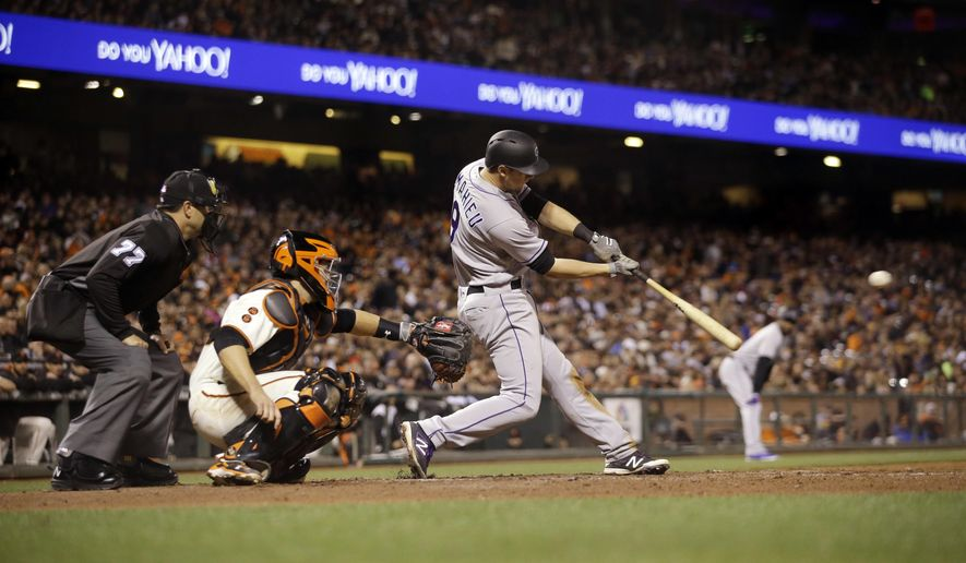 Colorado Rockies' DJ LeMahieu drives in a run with a single against the San Francisco Giants during the fifth inning of a baseball game Thursday, May 5, 2016, in San Francisco. (AP Photo/Marcio Jose Sanchez)