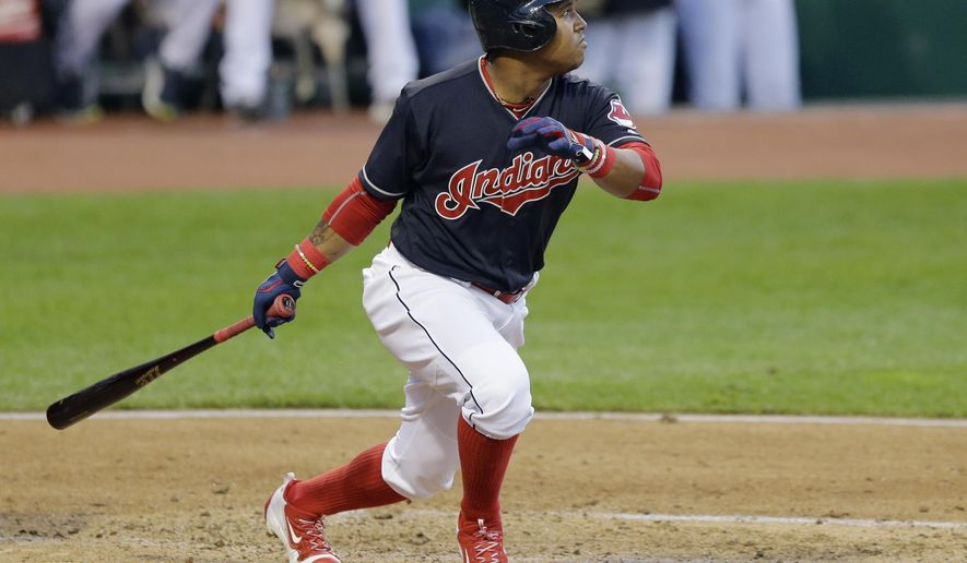 Cleveland Indians' Jose Ramirez watches his ball after hitting a three-run double off Kansas City Royals starting pitcher Yordano Ventura in the third inning of a baseball game, Friday, May 6, 2016, in Cleveland. Michael Brantley, Yan Gomes, and Lonnie Chisenhall scored on the play. (AP Photo/Tony Dejak)
