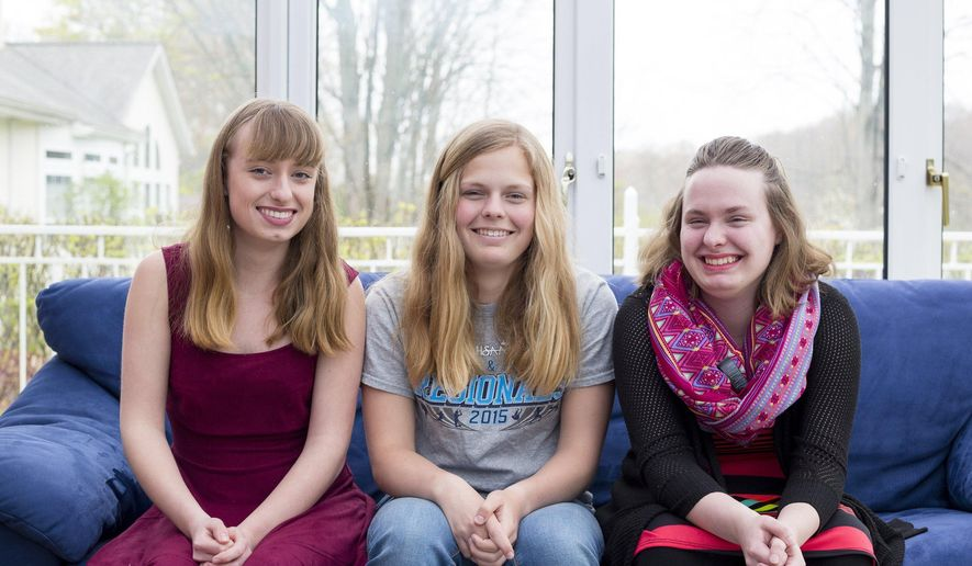 This April 30, 2016 photo shows Baye Lee, Allie and Jenna Braschler in their home in Grand Rapids, Mich.   Triplets born 15 weeks premature in 1997 are set to graduate at their top of their class at Saugatuck High School in late May.  The trio has also served as class president, vice president and treasurer in their senior year, among other activities. (Nick Gonzales/The Grand Rapids Press via AP) ALL LOCAL TELEVISION OUT; LOCAL TELEVISION INTERNET OUT; MANDATORY CREDIT