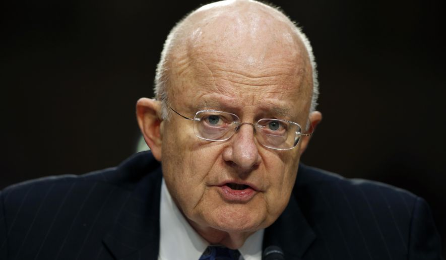 FILE - In this Feb. 9, 2016 file photo, Director of the National Intelligence James Clapper testifies on Capitol Hill in Washington. Even though bulk collection of Americans' phone records has ended, calls and emails are still being swept up by U.S. surveillance work targeting foreigners. There is a renewed push to find out how many. (AP Photo/Alex Brandon, File)