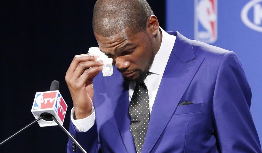 FILE - In this May 6, 2014 file photo, Oklahoma City Thunder's Kevin Durant wipes away tears as he speaks during a news conference after the announcement that he had won the 2013-14 Kia NBA Basketball Most Value Player Award, in Oklahoma City.  In an emotional tribute, he thanked his mother, Wanda Pratt, for her sacrifices as he and his brother grew up in Washington, D.C. Durant's mother, Wanda, is the subject of a Lifetime original movie called The Real MVP: The Wanda Durant Story, which will premiere on May 7. (AP Photo/Sue Ogrocki, File)