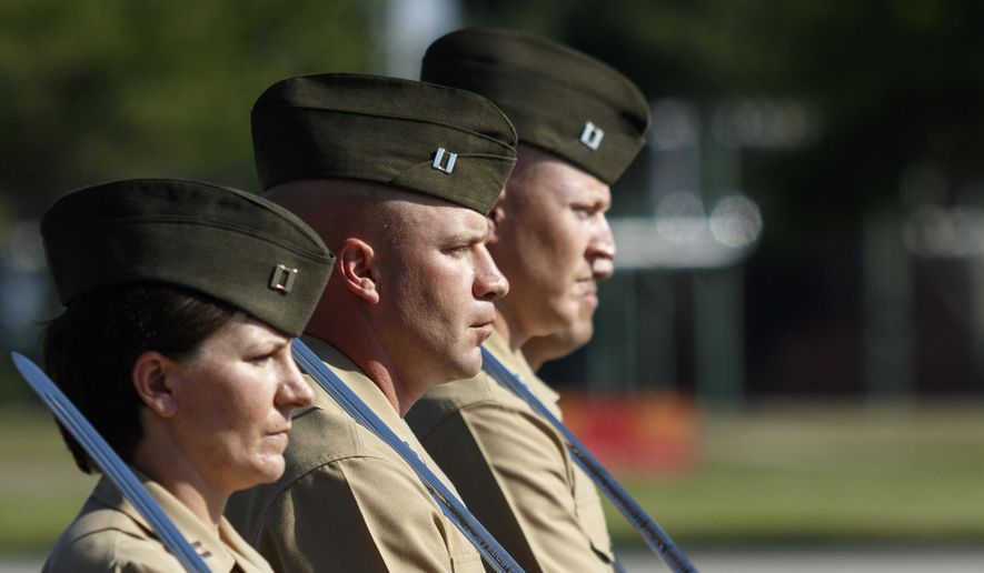 In this Friday, April 29, 2016 photo, Marine Corps captains march with swords in a graduation ceremony for new Marines at the Marine Corps Recruit Depot in Parris Island, S.C. 379 new Marines graduated from boot camp Friday. (Doug Strickland/Chattanooga Times Free Press via AP) THE DAILY CITIZEN OUT; NOOGA.COM OUT; CLEVELAND DAILY BANNER OUT; LOCAL INTERNET OUT; MANDATORY CREDIT