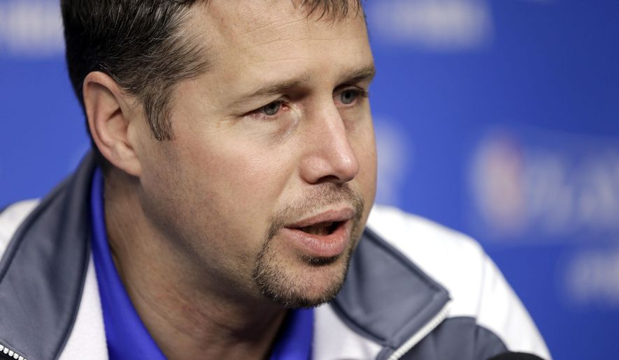 FILE - In this April 23, 2016 file photo, Memphis Grizzlies head coach David Joerger talks with reporters in Memphis, Tenn. The Grizzlies have fired Joerger after three seasons and three straight playoff appearances. The Grizzlies announced the decision Saturday, May 7, 2016.  (AP Photo/Mark Humphrey)