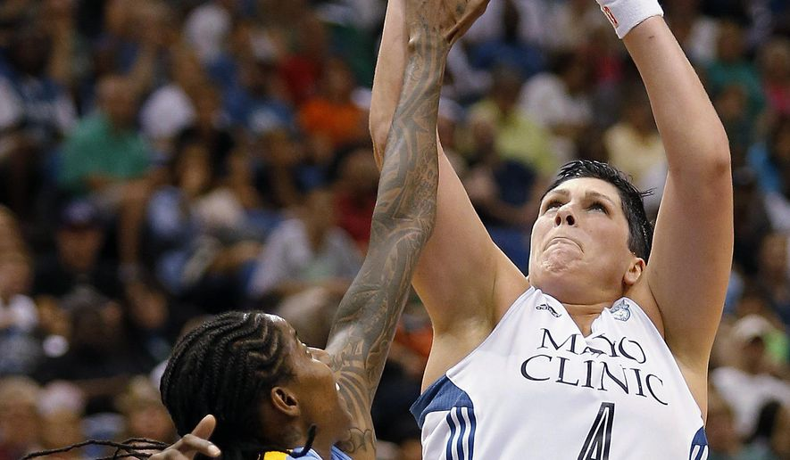 FILE - In this Aug. 7, 2014, file photo, Minnesota Lynx center Janel McCarville (4) is fouled by Chicago Sky forward Jessica Breland as she shoots during the second half of a WNBA basketball game in Minneapolis. The Lynx have reacquired McCarville. The defending WNBA champions announced the signing Saturday, May 7, 2016. Terms were not released.  Before the 2015 season, McCarville told the Lynx she would sit out for that season. She recently played in the Turkish League.  (AP Photo/Stacy Bengs, File)